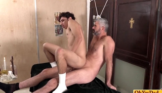 Priest moans as young twink bounces on his hard cock